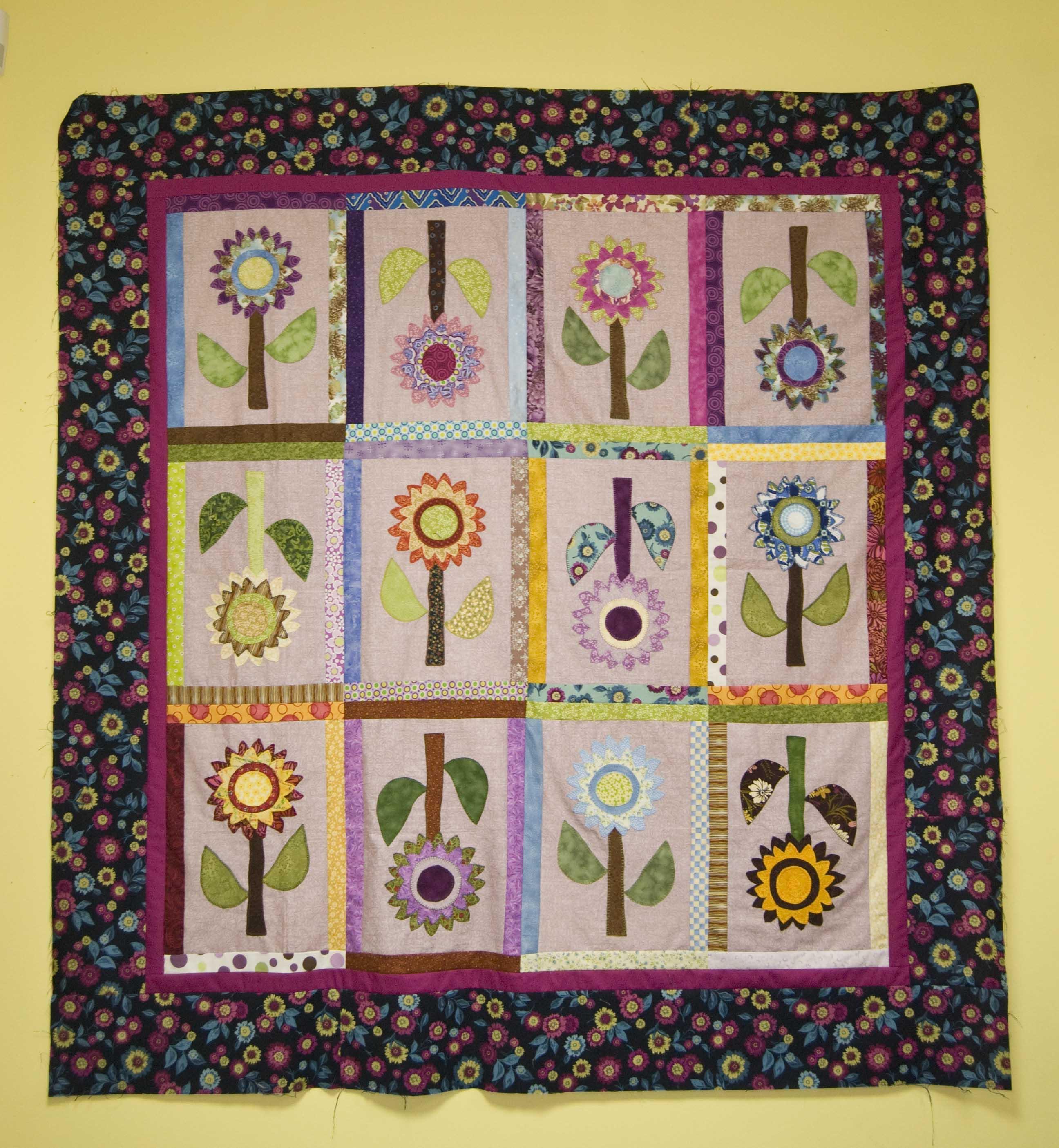 Colcha flores la rueca patchwork su tienda de labores en internet - Colcha patchwork ...